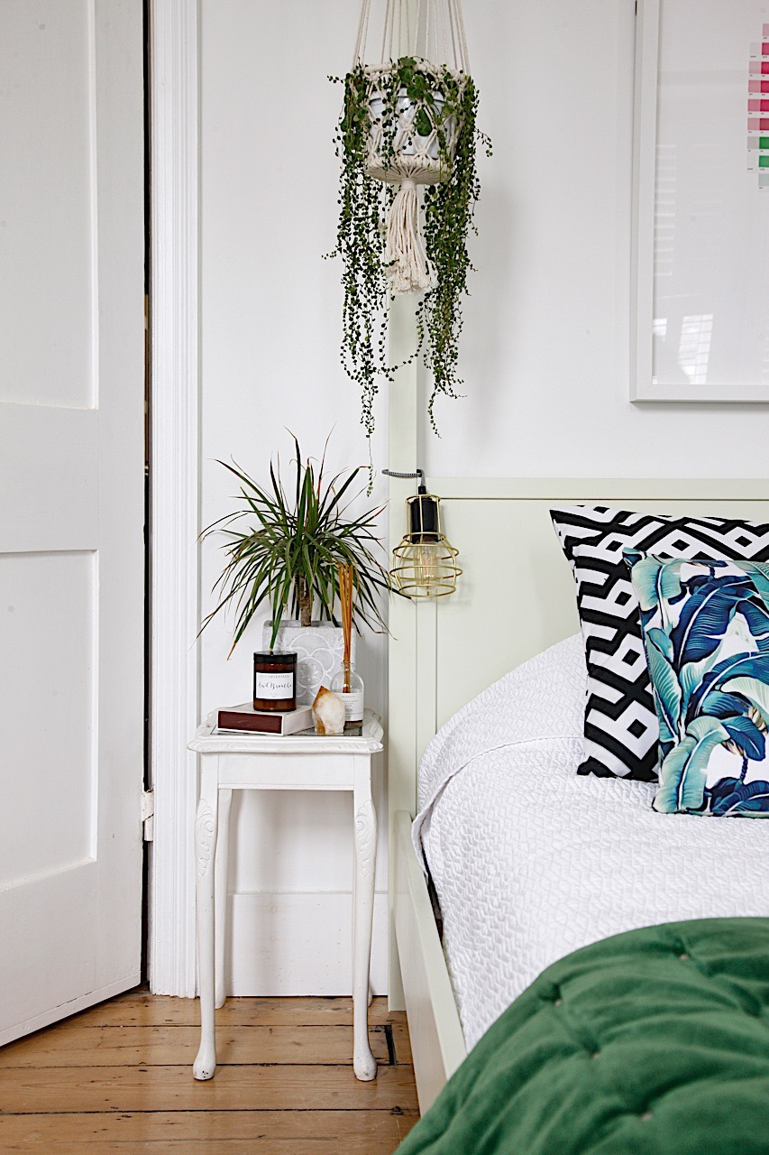 White and green bedroom with upcycled bedside table