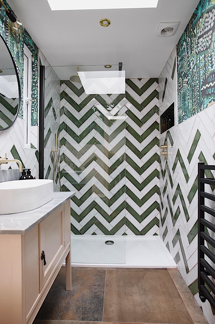 Bold shower room with zig zag herringbone tile and vintage washstand