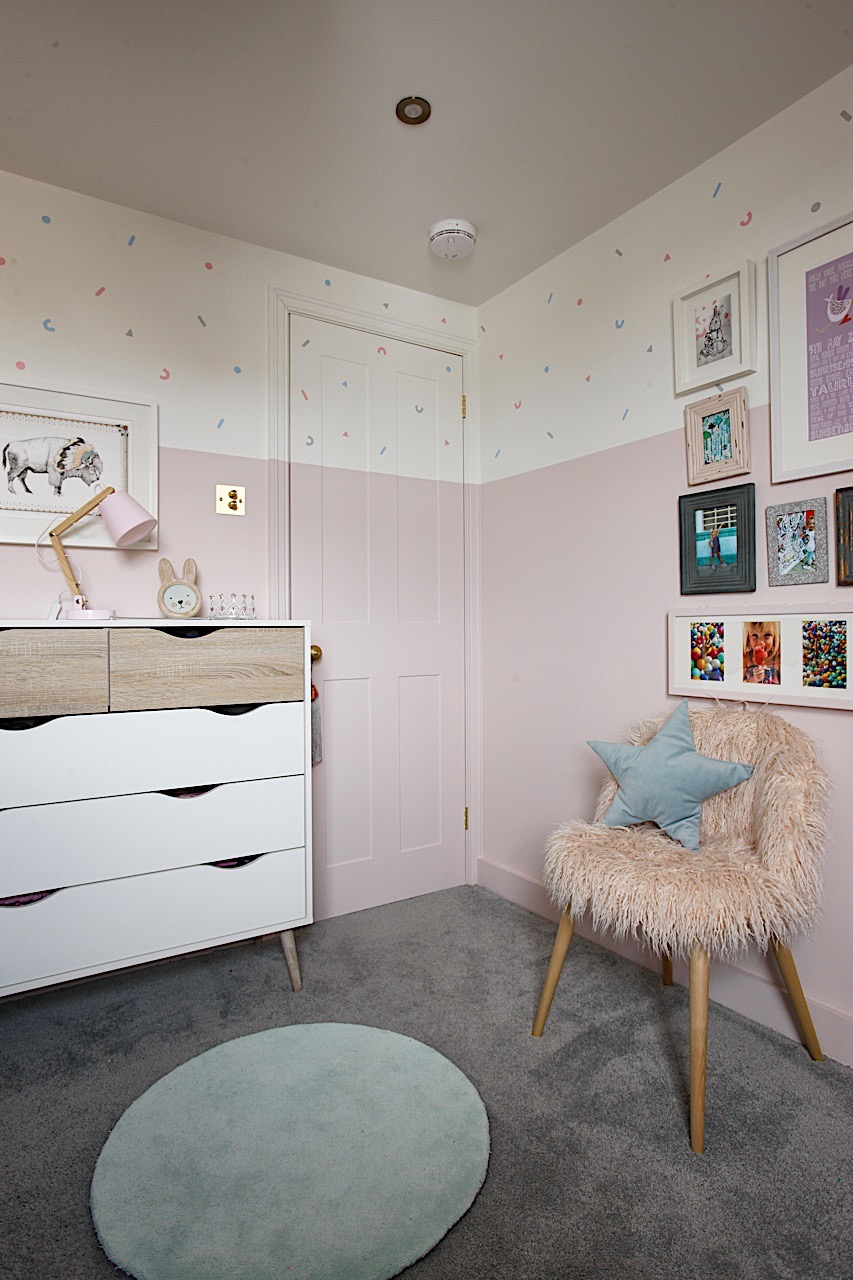 Pastel pink girls bedroom with wall decals